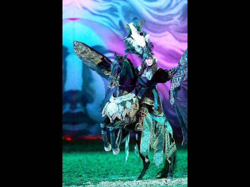 Riders symbolizing princes willing to conquer Apollo, perform in a mythological stage during the show