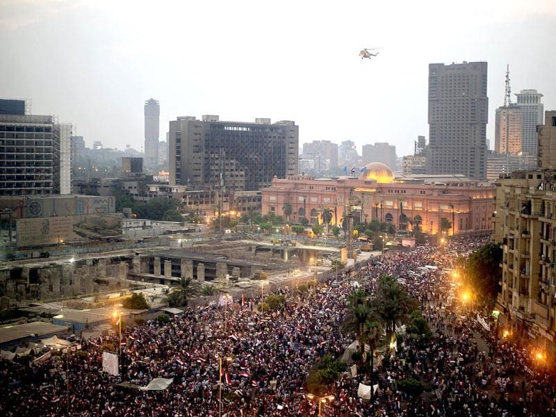 An Egyptian army helicopter flies over protesters calling for the ouster of President Mohamed Morsi in Cairo's landmark Tahrir Square. (AFP)