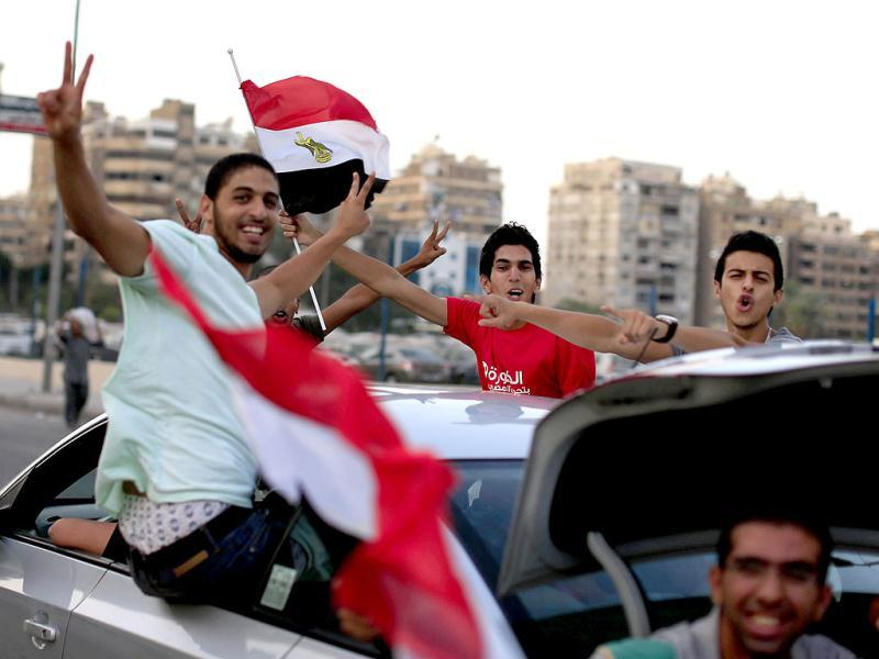 Opponents of Islamist President Mohammed Morsi flash victory signs and wave national flags in Cairo, Egypt. (AP)