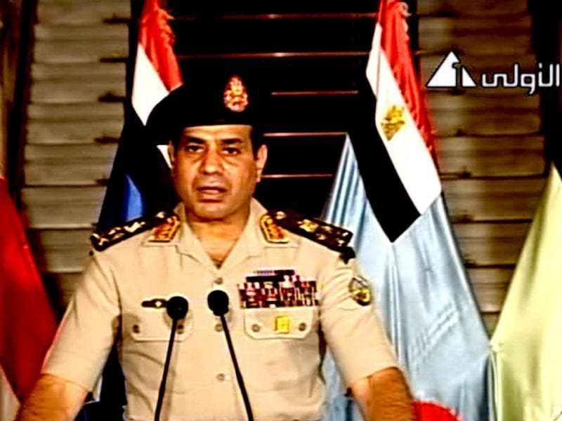 Lt. Gen. Abdel-Fattah el-Sissi address the nation on Egyptian State Television Wednesday. He said that president was replaced by chief justice of constitutional court. (AP)