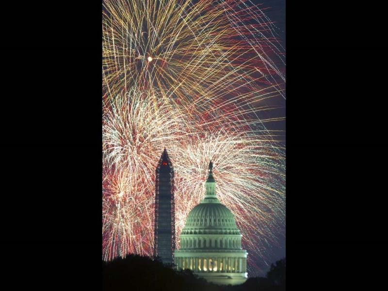 Fourth of July Independence Day fireworks are seen over the US Capitol and Washington Monument in Washington, DC. (AFP)