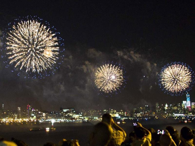 People watch the fireworks erupt over Hudson River, with the skyline of New York in the background, during the Macy's Independence Day celebration in New Jersey. (Reuters)