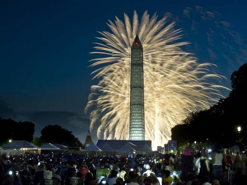 Fourth of July Independence Day fireworks seen over the Washington Monument in Washington, DC. (AFP)