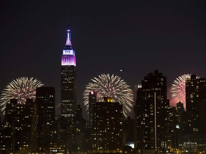 Fireworks light up the Empire State Building along the Manhattan skyline during Macy's 37th Annual Fourth of July fireworks show in New York. (AP)