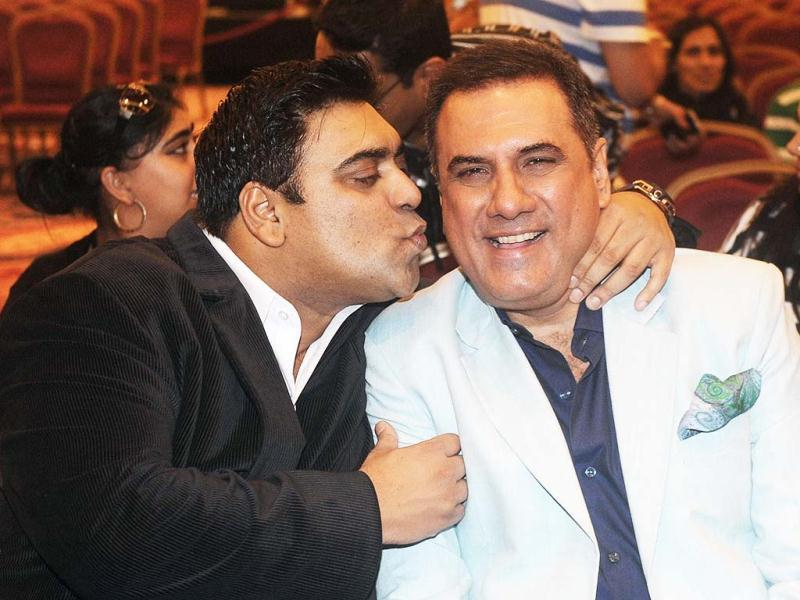 Actor Ram Kapoor could not help but kiss Boman Irani. The makers of Santa Banta - starring Ram Kapoor and Boman Irani held a press conference at Venetian Macao after IIFA 2013 raised its curtains. (AFP Photo)