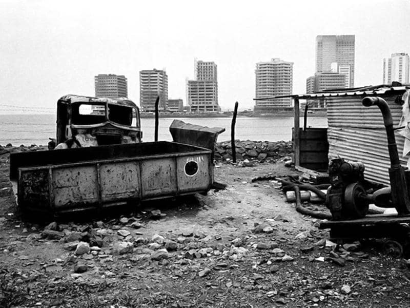 Photographs that capture a sense of absence – a car at Nariman Point after it has been dismembered, empty streets wrapped in silence, a ship diner after dinner is over. (Photo courtesy: Pablo Bartholomew/Photoink)