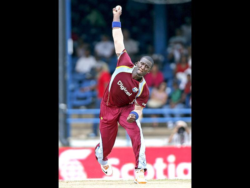 West Indies' Darren Sammy bowls during the Tri-nation series cricket match against India in Port-of-Spain, Trinidad. (AP)