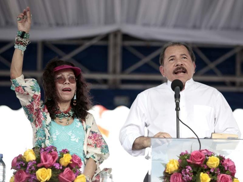 Nicaragua's President Daniel Ortega (R) speaks as his wife Rosario Murillo gestures during a ceremony marking the 34th anniversary of the withdrawal to Masaya in Nicaragua. (AP)