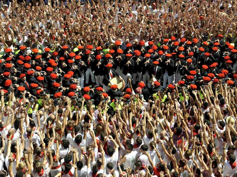 Pamplona's municipal music band passes revellers in the town hall square at the start of the San Fermin festival in Pamplona. Reuters