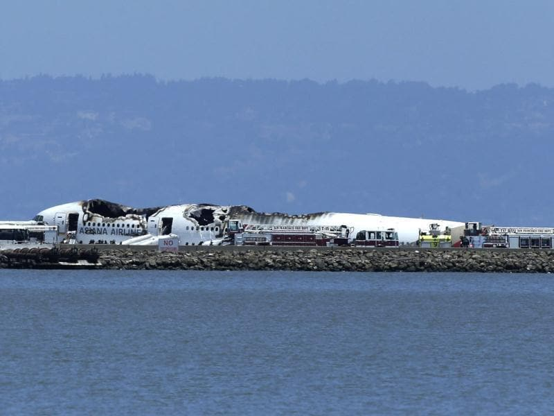 Full view of Asiana Airlines flight which crashed while landing at San Francisco airport on Saturday, July 6, 2013. It was not immediately known whether there were any injuries. (AP Photo/Antonette Edwards )