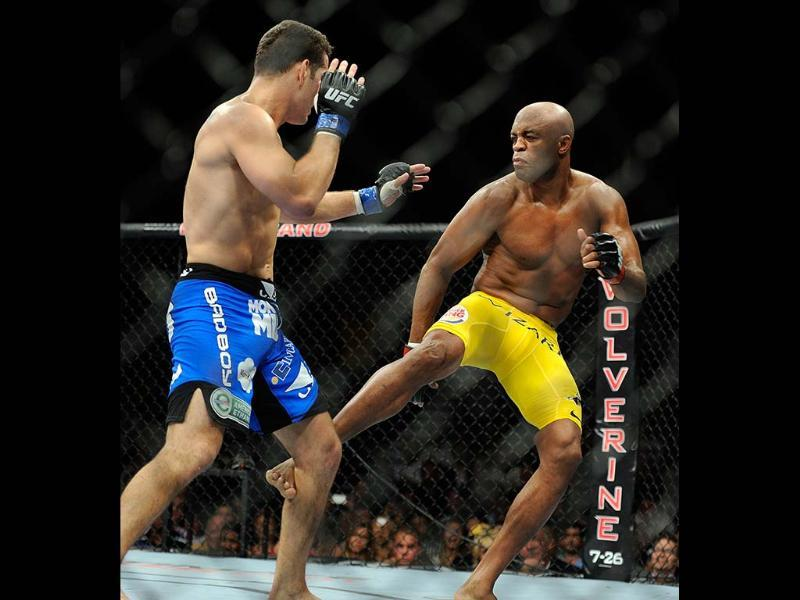 Chris Weidman, left, and Anderson Silva battle it out during their UFC 162 mixed martial arts middleweight championship bout at the MGM Grand Garden Arena in Las Vegas. AP