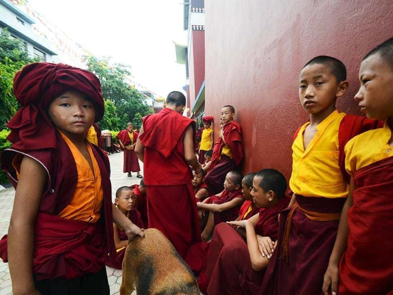 Novice Buddhist monks wait outside the Tergar Monastery, the site of a blast, in Bodhgaya, about 140kms southwest of Patna. AP