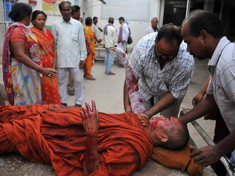 An injured Buddhist monk receives medical treatment following 9 low-intensity serial blasts at the Bodh Gaya Buddhist temple complex, at a hospital in Gaya. AFP