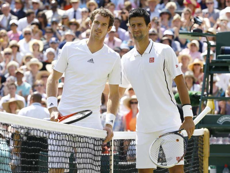 Andy Murray and Novak Djokovic pose for photographers before the Men's singles final match at the All England Lawn Tennis Championships in Wimbledon, London. AP