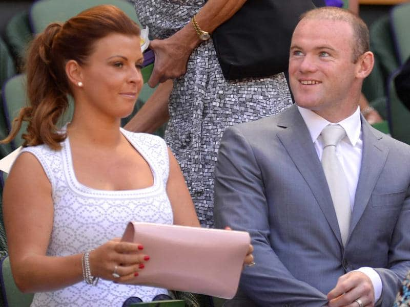 Manchester United's Wayne Rooney and his wife Coleen sit in the royal box to watch the Wimbledon men's singles final between Novak Djokovic and Andy Murray in London. AFP