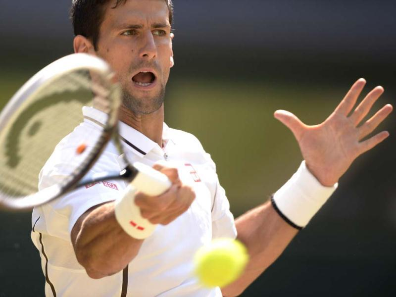 Novak Djokovic returns against Andy Murray during the Wimbledon men's singles final in London. AFP