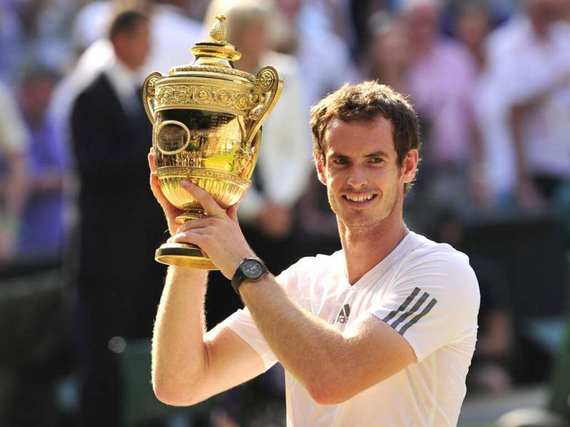 Andy Murray raises the winner's trophy after beating Novak Djokovic in the Wimbledon men's singles final in London. AFP