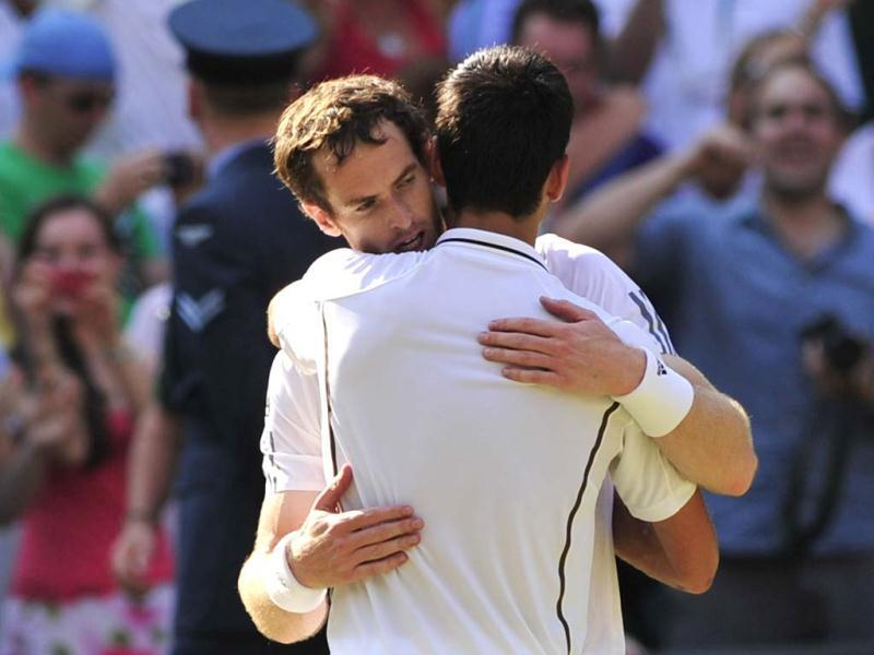 Andy Murray embraces Novak Djokovic after Murray's victory in Wimbledon men's singles final in Wimbledon. AFP Photo