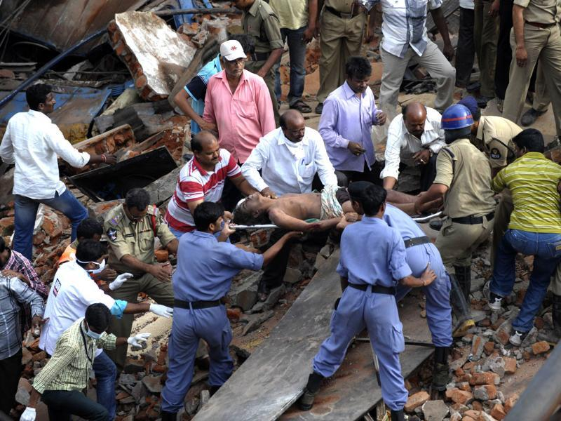 So far eight bodies have been removed from the collapsed building and many are feared trapped under debris. (AFP Photos)