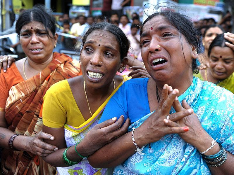 Unidentified women cry after hearing the news of their relative killed in the building collapsed. (AP Photos)