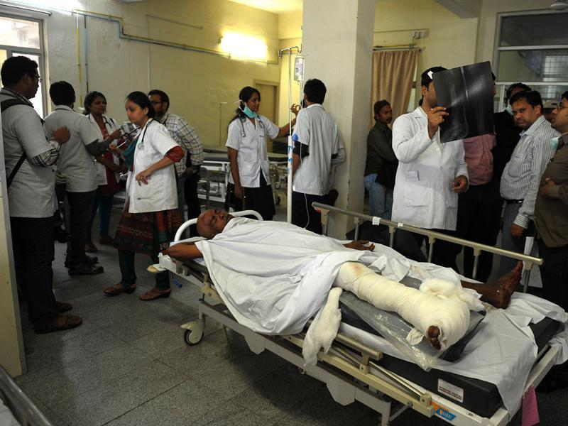 Doctors look at the x-rays of an injured patient at a hospital in Secunderabad, the twin city of Hyderabad. (AFP Photos)