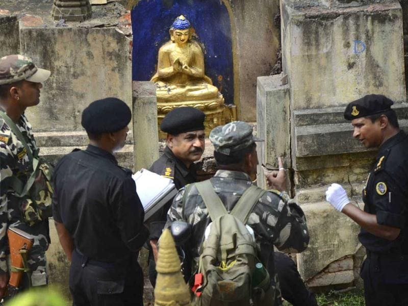 National security guards inspect the site a day after the serial blasts in Mahabodhi Temple in Bodh Gaya. (AP Photo)