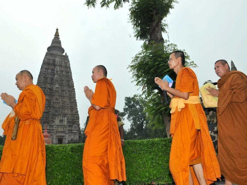 Buddhist monks offer prayers at Mahabodhi temple in Bodh Gaya a day after serial explosions at the site. (PTI Photo)