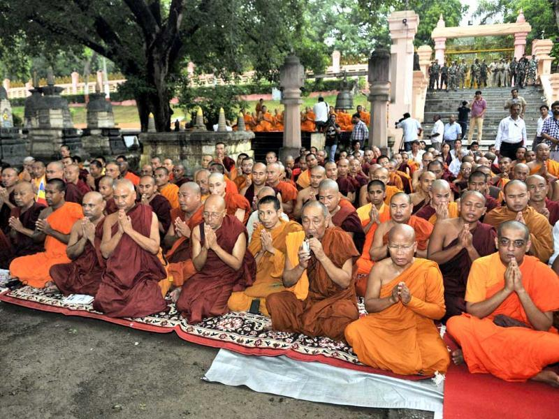 Buddhist monks offer prayers for peace at Mahabodhi Temple in Bodh Gaya a day after serial explosions at the site. (PTI Photo)