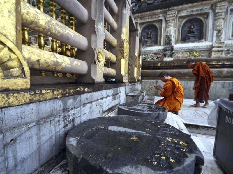 Buddhist monks offer prayers a day after a series of blasts hit Mahabodhi temple in Bodh Gaya at the site. (AP Photo)