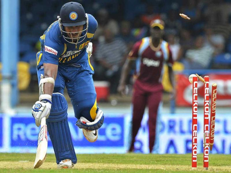 Sri Lankan cricketer Kumar Sangakkara makes his ground during the fifth match of the Tri-Nation series between Sri Lanka and West Indies at the Queen's Park Oval stadium in Port of Spain. AFP Photo