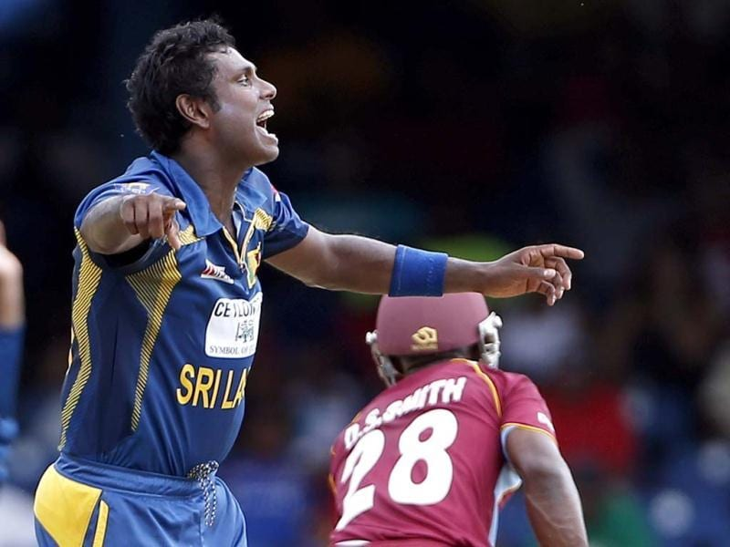 Sri Lanka's Angelo Mathews celebrates after trapping West Indies batsman Devon Smith LBW for a duck during their Tri-Nation Series cricket match in Port-of-Spain, Trinidad. AP Photo