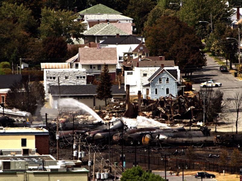 Wreckage of a derailed train that ignited tanker cars carrying crude oil strewn through the downtown core in Canada. (AP Photo)