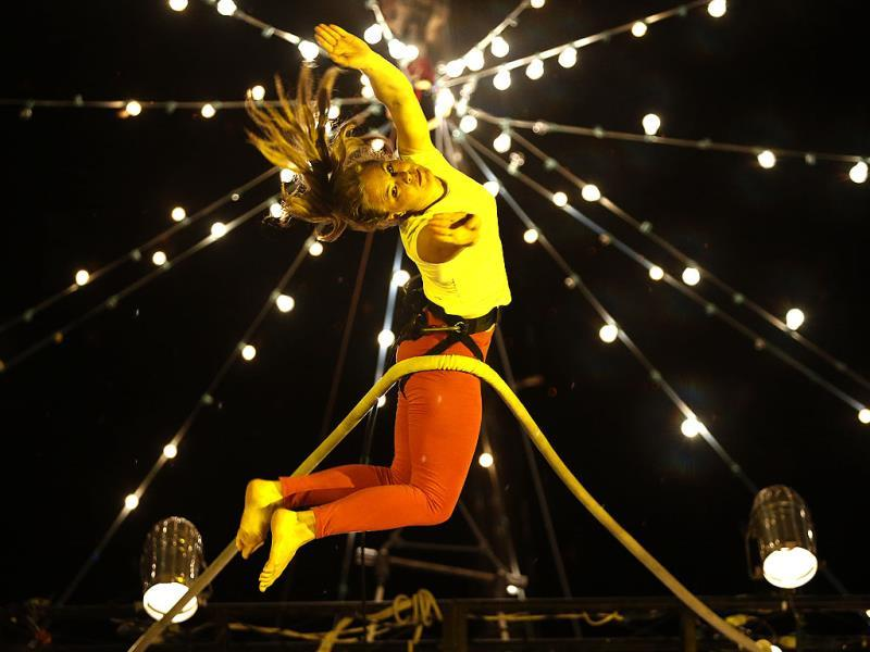 A trapeze artist performs in the dress rehearsal of