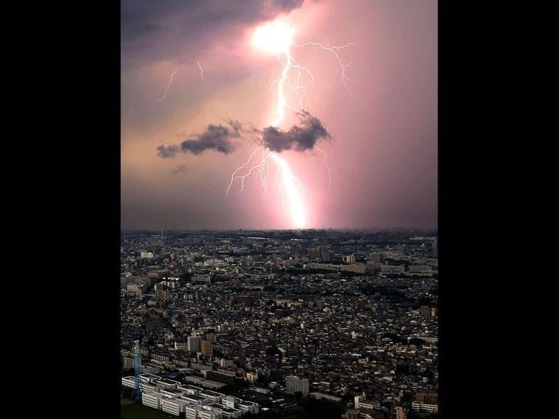 Lightening flashes over Saitama prefecture in Tokyo, Japan. (AP Photo)