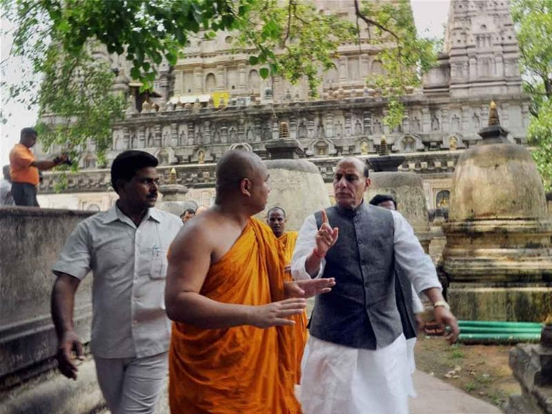 Bodhgaya: BJP president Rajnath Singh interacts with a priest during his visit to the Mahabodhi Temple at Bodhgaya on Tuesday, two days after the serial blasts. (PTI Photo)