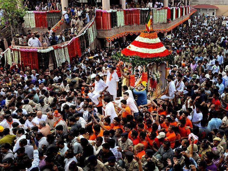 Devotees pulling chariot in Ahmedabad. PTI Photo