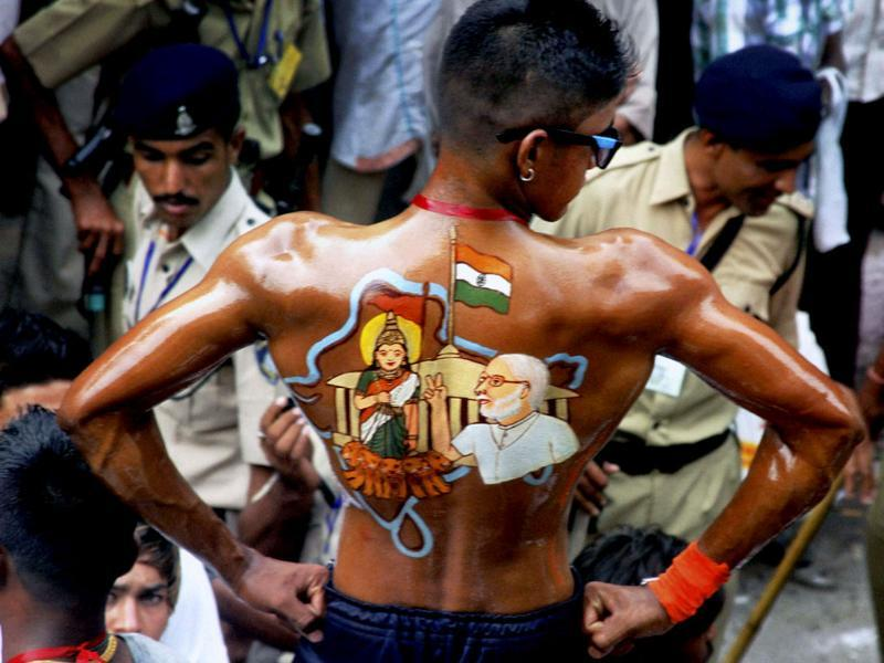 A devotee with colourful illusrations on his his back with an image during the 136th annual Rath Yatra in Ahmedabad. PTI Photo