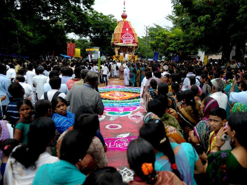 Indian devotees of The International Society of Krishna Conciousness (ISKON) participate in a ritual or 'puja' at the start of the Sri Jagannatha Ratha Yatra in Hyderabad on July 10, 2013. PTI