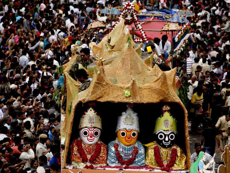 During the festival the idols of Hindu god Jagannath, his brother Balabhadra and sister Subhadra are taken out in a grand procession in specially made chariots pulled by thousands of devotees. (AP Photo/Ajit Solanki)