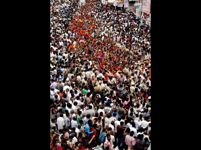 Devotees throng streets in Ahmedabad . PTI