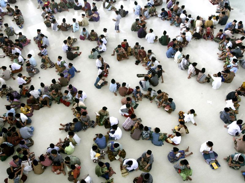 Students sit in circles during a Quran recital class on the first day of the holy fasting month of Ramadan, at Ar-Raudlatul Hasanah Islamic boarding school in Medan, North Sumatra, Indonesia, Wednesday, July 10, 2013. During Ramadan Muslims refrain from eating, drinking, smoking and sex from dawn to dusk. AP Photo