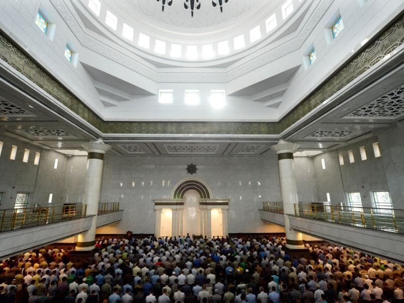 Indonesian Muslims pray at a mosque on the first day of the holy month of Ramadan in Jakarta on July 10, 2013. Islam's holy month of Ramadan is celebrated by Muslims worldwide marked by fasting, abstaining from foods, sex and smoking from dawn to dusk for soul cleansing and strengthening the spiritual bond between them and the Almighty. AFP PHOTO