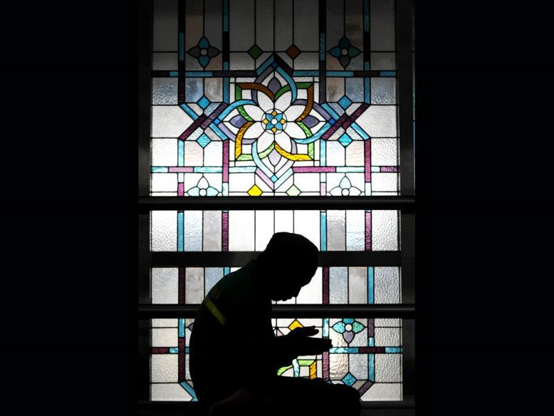 An Indonesian Muslim man prays at a mosque on the first day of the holy month of Ramadan in Jakarta on July 10, 2013. Islam's holy month of Ramadan is celebrated by Muslims worldwide marked by fasting, abstaining from foods, sex and smoking from dawn to dusk for soul cleansing and strengthening the spiritual bond between them and the Almighty. AFP PHOTO