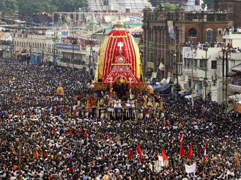 Devotees throng around the chariot of Lord Jagannath during the annual rath yatra or chariot procession in Puri, 60 kilometers (37 miles) from Bhubaneswar. (AP Photo)