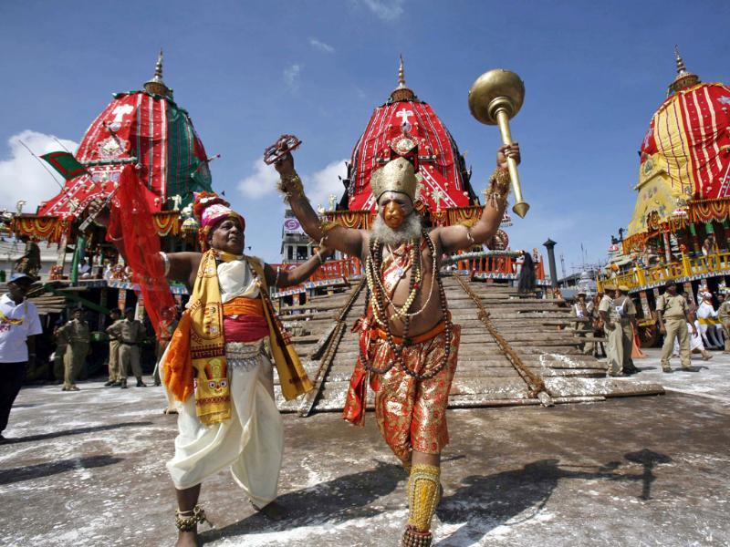Traditional dancers of the Shree Jagannath temple dance during the annual rath yatra or chariot procession of Lord Jagannath in Puri, 60 kilometers (37 miles) from Bhubaneswar. (AP Photo)