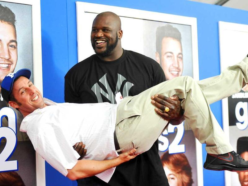 Former professional basketball player Shaquille O'Neal gives actor Adam Sandler a lift at the premiere of Grown Ups 2 at the AMC Loews Lincoln Square in New York. AP