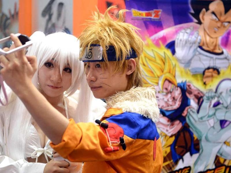 Cosplay fans poses for photos on the opening day of the 9th China International Comics Games Expo (CCG Expo) in Shanghai. AFP Photo