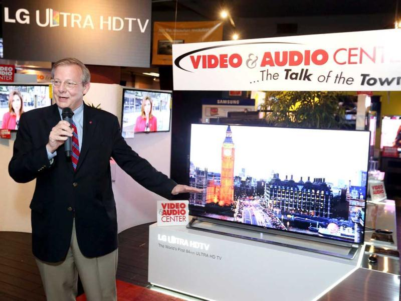 John I Taylor, vice president, LG Electronics USA, demonstrates the new 65-inch LG Ultra HDTV now on sale for the first time in Santa Monica, California. AP