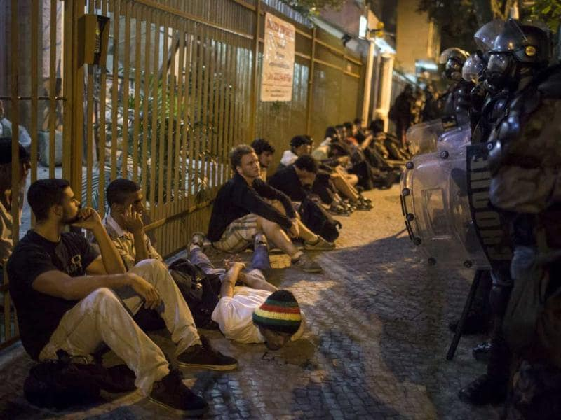 Protesters sit on the ground after being detained by police near the state governor's office at Guanabara Palace during a nationwide strike in Rio de Janeiro. AP