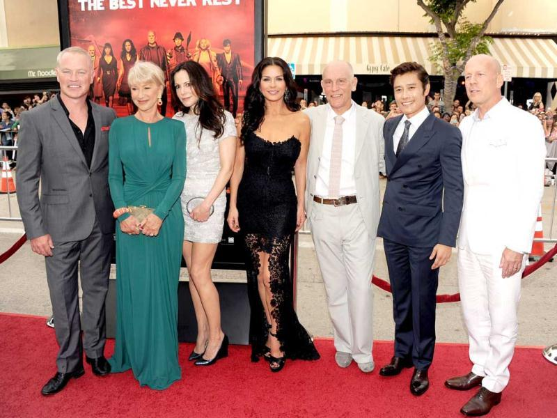 (L-R) Actors Neal McDonough, Helen Mirren, Mary-Louise Parker, Catherine Zeta-Jones, John Malkovich, Byung-hun Lee, and Bruce Willis attend the premiere of Summit Entertainment's RED 2 at Westwood Village in Los Angeles, California. AFP